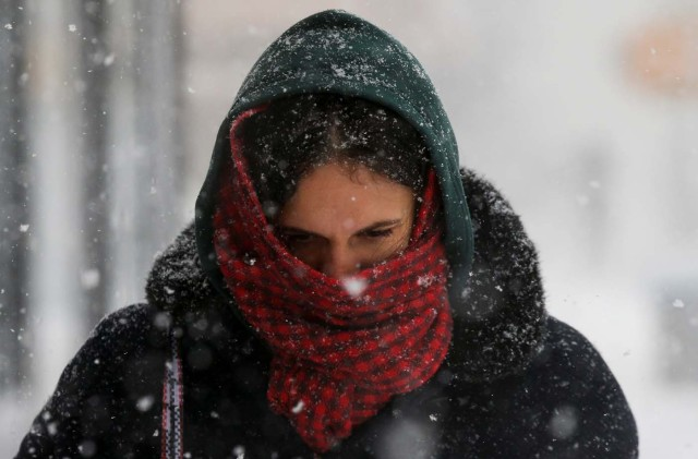 A woman struggles against wind and snow during a snowstorm in the Brooklyn borough of New York City, U.S., January 4, 2018. REUTERS/Brendan McDermid
