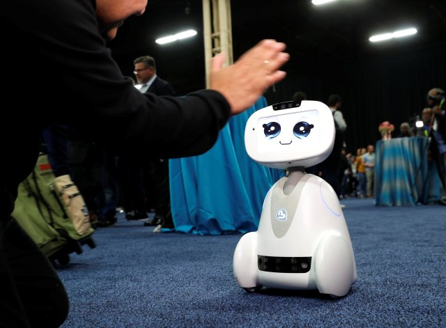 Buddy, an entertainment and assistant robot by Blue Frog Robotics, interacts with a attendee during CES Unveiled at the 2018 CES in Las Vegas, Nevada, U.S. January 7, 2018. REUTERS/Steve Marcus