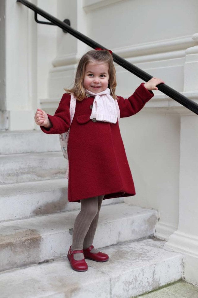 Britain's Princess Charlotte stands on the steps at Kensington Palace shortly before she left for her first day of nursery at the Willcocks Nursery School in a photograph taken taken by her mother and handed out by Britain's Prince William and Catherine, the Duchess of Cambridge in London, January 8, 2018. The Duchess of Cambridge handout via REUTERS Copyright: HRH The Duchess of Cambridge 2018. NEWS EDITORIAL USE ONLY. NO COMMERCIAL USE (including any use in merchandising, advertising or any other non-editorial use including, for example, calendars, books and supplements). This photograph is provided to you strictly on condition that you will make no charge for the supply, release or publication of it and that these conditions and restrictions will apply (and that you will pass these on) to any organisation to whom you supply it. All other requests for use should be directed to the Press Office at Kensington Palace in writing. NOTE TO EDITORS: This handout photo may only be used in for editorial reporting purposes for the contemporaneous illustration of events, things or the people in the image or facts mentioned in the caption. Reuse of the picture may require further permission from the copyright holder.