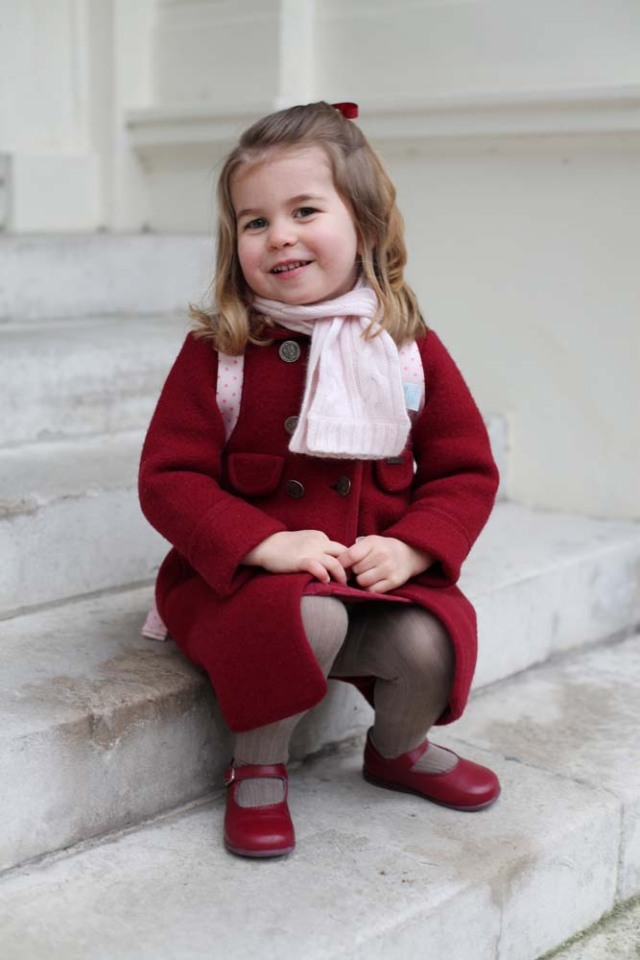 Britain's Princess Charlotte sits on the steps at Kensington Palace shortly before she left for her first day of nursery at the Willcocks Nursery School in a photograph taken taken by her mother and handed out by Britain's Prince William and Catherine, the Duchess of Cambridge in London, January 8, 2018. The Duchess of Cambridge handout via REUTERS Copyright: HRH The Duchess of Cambridge 2018. NEWS EDITORIAL USE ONLY. NO COMMERCIAL USE (including any use in merchandising, advertising or any other non-editorial use including, for example, calendars, books and supplements). This photograph is provided to you strictly on condition that you will make no charge for the supply, release or publication of it and that these conditions and restrictions will apply (and that you will pass these on) to any organisation to whom you supply it. All other requests for use should be directed to the Press Office at Kensington Palace in writing. NOTE TO EDITORS: This handout photo may only be used in for editorial reporting purposes for the contemporaneous illustration of events, things or the people in the image or facts mentioned in the caption. Reuse of the picture may require further permission from the copyright holder.