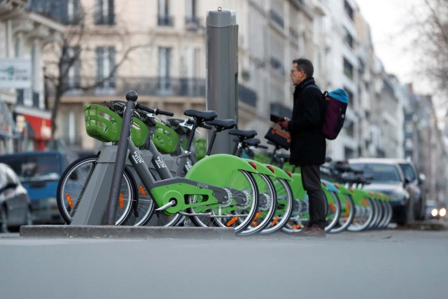 A man checks out a new Velib' Metropole self-service public bike by the Smovengo at a distribution point in Paris, France January 8, 2018. REUTERS/Gonzalo Fuentes