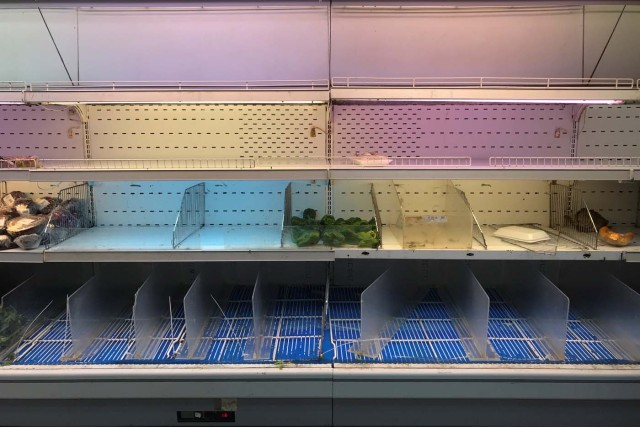 An empty refrigerator is seen at a supermarket in Caracas, Venezuela January 9, 2018. REUTERS/Marco Bello