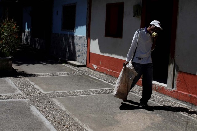 Yoffre Echarri eats from a cocoa pod as he walks close to his house in Caruao, Venezuela October 24, 2017. Picture taken October 24, 2017. REUTERS/Carlos Garcia Rawlins