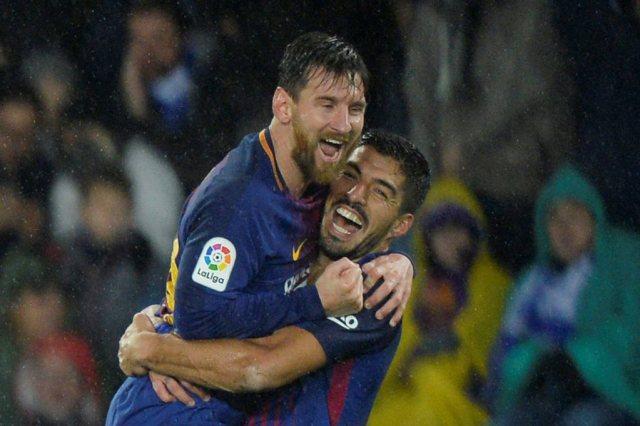Lionel Messi y Luis Suárez. REUTERS/Vincent West