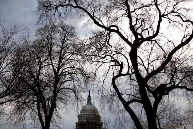 Clouds pass over the U.S. Capitol at the start of the third day of a shut down of the federal government in Washington, U.S., January 22, 2018. REUTERS/Joshua Roberts