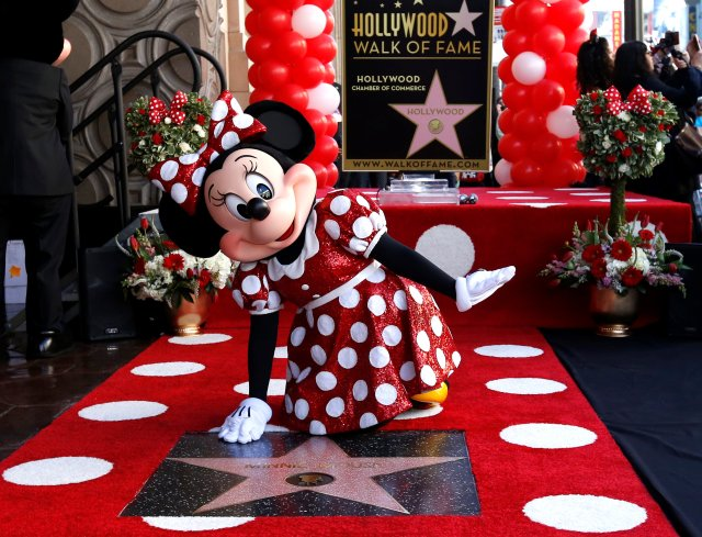 The character of Minnie Mouse poses on her star after it was unveiled on the Hollywood Walk of Fame in Los Angeles, California, U.S., January 22, 2018. REUTERS/Mario Anzuoni