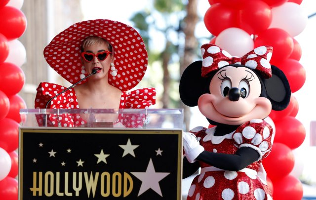 Singer Katy Perry speaks next to the character of Minnie Mouse at the unveiling of her star on the Hollywood Walk of Fame in Los Angeles, California, U.S., January 22, 2018. REUTERS/Mario Anzuoni