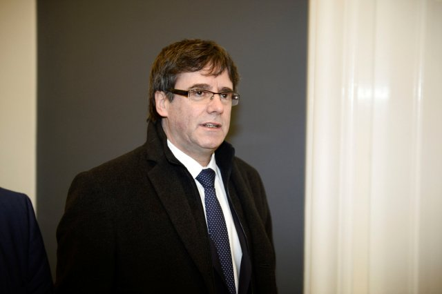 The Catalan separatist leader Carles Puigdemont arrives for a meeting with Danish members of Parliament, after being invited by the Faroese parliamentary member Magni Arge, at Christiansborg in Copenhagen, Denmark January 23, 2018. Mads Claus Rasmussen/Scanpix Denmark via REUTERS ATTENTION EDITORS - THIS IMAGE WAS PROVIDED BY A THIRD PARTY. DENMARK OUT. NO COMMERCIAL OR EDITORIAL SALES IN DENARK.