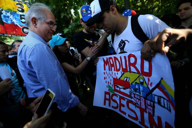 "Antonio Ledezma, Venezuelan opposition leader, attends a rally as members of the Lima Group nations meet in Santiago, Chile January 23, 2018. The banner reads ""Maduro murderer"". REUTERS/Ivan Alvarado"