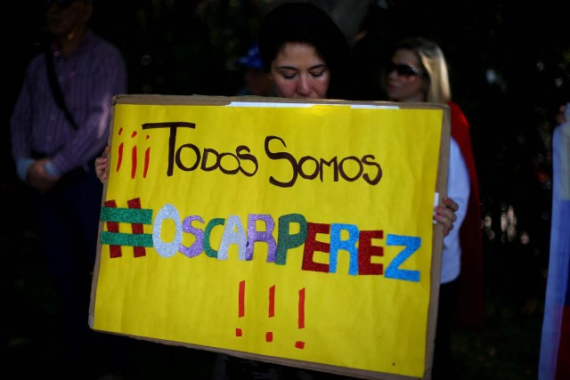 "A woman holds a banner reading ""We are All Oscar Perez!"", regarding Venezuelan ex-policeman, during a rally against Venezuela's government as members of Lima Group nations meet in Santiago, Chile January 23, 2018. REUTERS/Ivan Alvarado"