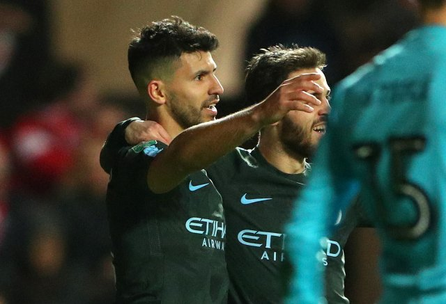 """Soccer Football - Carabao Cup Semi Final Second Leg - Bristol City vs Manchester City - Ashton Gate Stadium, Bristol, Britain - January 23, 2018   Manchester City's Sergio Aguero celebrates scoring their second goal               REUTERS/Hannah Mckay    EDITORIAL USE ONLY. No use with unauthorized audio, video, data, fixture lists, club/league logos or """"live"""" services. Online in-match use limited to 75 images, no video emulation. No use in betting, games or single club/league/player publications.  Please contact your account representative for further details."""
