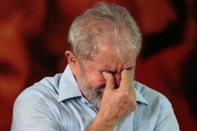 Former Brazilian president Luiz Inacio Lula da Silva reacts as he attends a meeting with members of the Workers Party (PT), that decided Lula da Silva will be its candidate again in the 2018 election, despite losing an appeal against a corruption conviction that will likely bar him, in Sao Paulo, Brazil, January 25, 2018. REUTERS/Leonardo Benassatto NO RESALES. NO ARCHIVES
