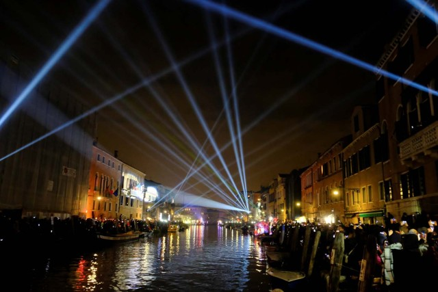 Cannaregio Channel is illuminated during the opening ceremony of the Carnival in Venice, Italy January 27, 2018. REUTERS/Manuel Silvestri