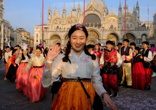 Dancers from South Korea perform during the Carnival in Saint Mark square in Venice, Italy January 28, 2018. REUTERS/Manuel Silvestri