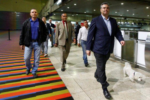 Spanish ambassador to Venezuela Jesus Silva (R) walks to the departure area at the Maiquetia international airport in Caracas, Venezuela January 29, 2018. REUTERS/Christian Veron