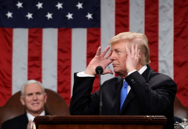 With Vice President Mike Pence looking on, U.S. President Donald Trump delivers his first State of the Union address to a joint session of Congress inside the House Chamber on Capitol Hill in Washington, U.S., January 30, 2018. REUTERS/Win McNamee/Pool