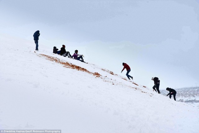3C51E2B300000578-4140326-Children_played_in_the_snow_on_the_dunes_above_the_town_of_Ain_S-a-100_1484920802887