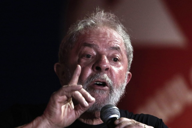 (FILES) This file photo taken on January 24, 2018 shows former Brazilian president Luiz Inacio Lula da Silva speaking during a rally in his support by trade unionists and members of social movements in Sao Paulo, Brazil. Brazilian President Michele Temer said on January 29, 2018 on a radio program that charismatic Lula is not dead politically despite his graft conviction was upheld by justice and his presidential candidacy is on stake. / AFP PHOTO / Miguel SCHINCARIOL