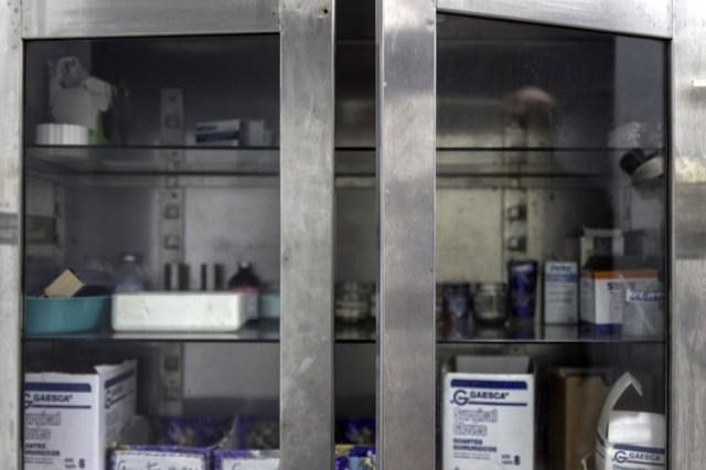 A sparse medical cabinet at a public hospital in Lechera, Venezuela. PHOTO: MARCELO PEREZ DEL CARPIO/BLOOMBERG NEWS