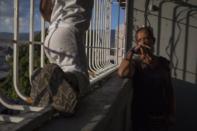 Elibeth Pulido, mother of the late Jose Daniel Bruzual, looks out the window of their home in Caracas.