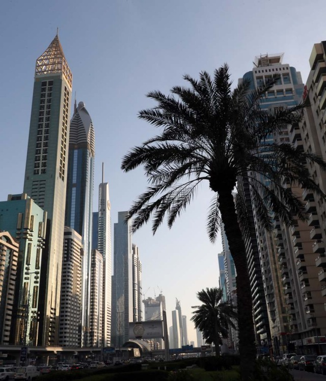 "A picture taken on February 11, 2018, shows the 75-storey Gevora Hotel (L), which stands 356 metres or nearly a quarter of a mile tall, in the Gulf metropolis of Dubai. Gulf metropolis Dubai, on its never-ending quest to break records, announced the opening of the ""world's new tallest hotel"" Sunday, pipping another towering landmark in the city for the title. / AFP PHOTO / KARIM SAHIB"