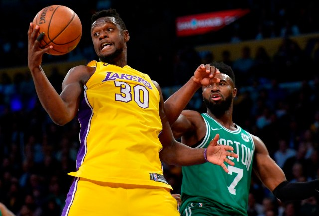 January 23, 2018; Los Angeles, CA, USA; Los Angeles Lakers forward Julius Randle (30) grabs a rebound in front of Boston Celtics guard Jaylen Brown (7) during the second half at Staples Center. Mandatory Credit: Gary A. Vasquez-USA TODAY Sports