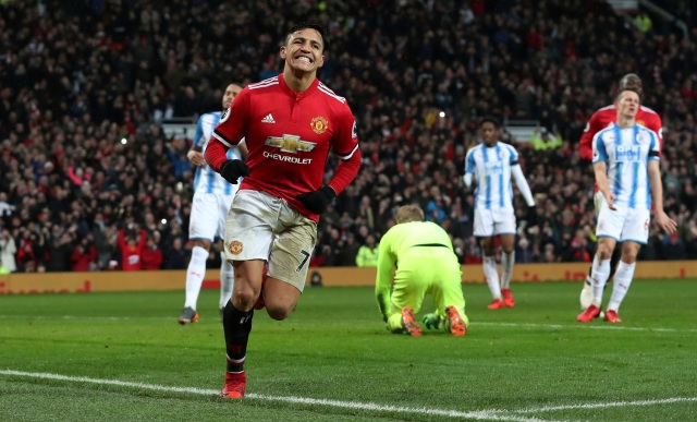"""Soccer Football - Premier League - Manchester United vs Huddersfield Town - Old Trafford, Manchester, Britain - February 3, 2018   Manchester United's Alexis Sanchez celebrates scoring their second goal    REUTERS/Scott Heppell    EDITORIAL USE ONLY. No use with unauthorized audio, video, data, fixture lists, club/league logos or """"live"""" services. Online in-match use limited to 75 images, no video emulation. No use in betting, games or single club/league/player publications.  Please contact your account representative for further details.     TPX IMAGES OF THE DAY"""