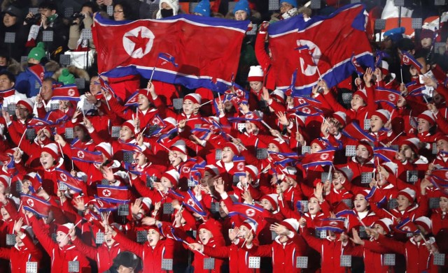 Pyeongchang 2018 Winter Olympics – Opening ceremony – Pyeongchang Olympic Stadium - Pyeongchang, South Korea – February 9, 2018 - Cheerleaders of North Korea wave their national flags as they wait the start of the opening ceremony. REUTERS/Kim Kyung-Hoon