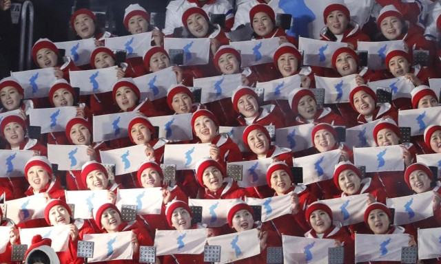 Pyeongchang 2018 Winter Olympics – Opening ceremony – Pyeongchang Olympic Stadium - Pyeongchang, South Korea – February 9, 2018 - Cheerleaders of North Korea hold unification flags as they wait the start of the opening ceremony. REUTERS/Kim Kyung-Hoon