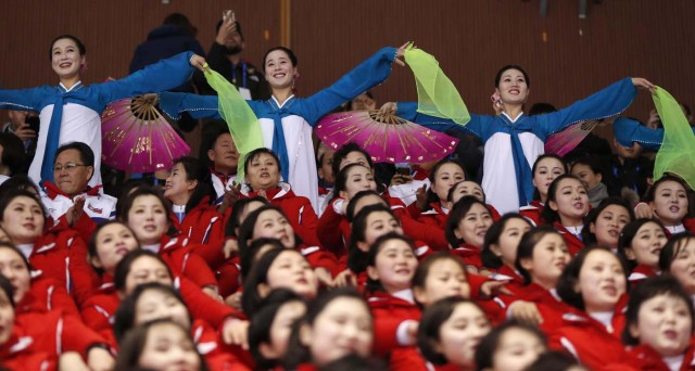 Short Track Speed Skating Events – Pyeongchang 2018 Winter Olympics – Men's 1500m Competition – Gangneung Ice Arena - Gangneung, South Korea – February 10, 2018 - North Korean cheerleaders in action. REUTERS/John Sibley