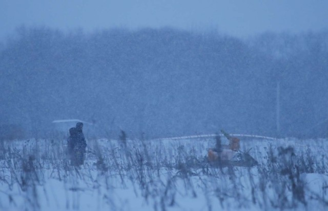 Emergency services work at the scene where a short-haul regional Antonov AN-148 plane crashed after taking off from Moscow's Domodedovo airport, outside Moscow, Russia February 11, 2018. REUTERS/Maxim Shemetov