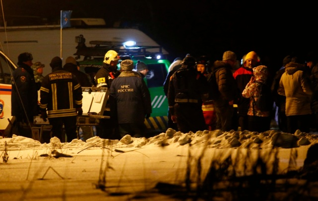 Emergency services work at the scene where a Saratov Airlines Antonov AN-148 plane crashed after taking off from Moscow's Domodedovo airport, outside Moscow, Russia February 11, 2018. REUTERS/Sergei Karpukhin