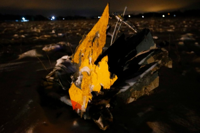 A part of a Saratov Airlines Antonov AN-148 plane that crashed after taking off from Moscow's Domodedovo airport, is seen at the scene of the incident outside Moscow, Russia February 11, 2018. REUTERS/Sergei Karpukhin