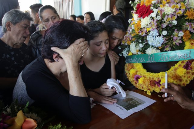Mourners react next to the coffin of Joel Contreras, who died during clashes between Venezuelan soldiers and illegal miners in Guasipati according to local media, during his funeral at the cemetery in Upata, Venezuela February 12, 2018. REUTERS/William Urdaneta NO RESALES. NO ARCHIVES