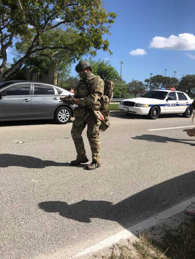 REFILE - ADDING INFORMATION   SWAT and police are seen in Coral Springs after a shooting at the Marjory Stoneman Douglas High School in Parkland, Florida, U.S. February 14, 2018 in this image obtained from social media. CREDIT: TWITTER / @GRUMPYHAUS via REUTERS ATTENTION EDITORS - THIS IMAGE WAS PROVIDED BY A THIRD PARTY. NO RESALES. NO ARCHIVES. MANDATORY CREDIT.  ATTENTION EDITORS - VISUAL COVERAGE OF SCENES OF INJURY OR DEATH  THIS PICTURE WAS PROCESSED BY REUTERS TO ENHANCE QUALITY. AN UNPROCESSED VERSION HAS BEEN PROVIDED SEPARATELY.