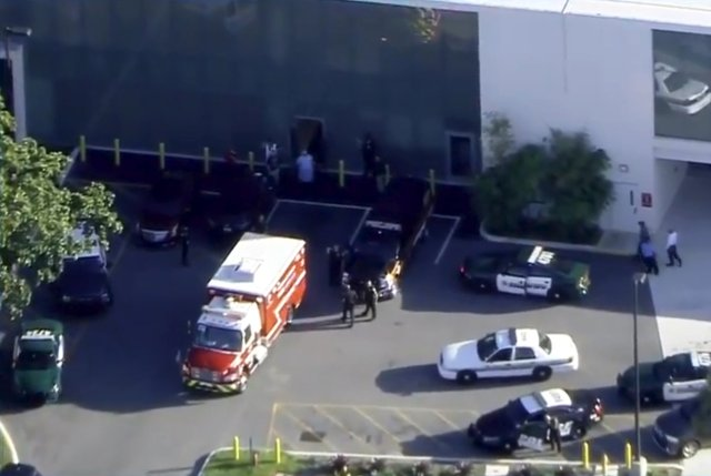 A fire department vehicle containing a man placed in handcuffs by police prepares to unload him at a hospital near Marjory Stoneman Douglas High School following a shooting incident in Parkland, Florida, U.S. February 14, 2018 in a still image taken from a video. WSVN.com via REUTERS. ATTENTION EDITORS - THIS IMAGES HAS BEEN PROVIDED BY A THIRD PARTY. NO RESALES, NO ARCHIVES. MANDATORY CREDIT. NO ACCESS SOUTHEAST FLORIDA MEDIA.