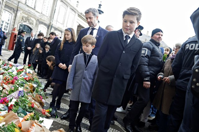 Danish Crown Prince Frederik and Prince Christian look at flowers in front of Amalienborg Palace in Copenhagen, Denmark, February 15, 2018. Ritzau Scanpix Denmark/Mads Claus Rasmussen via REUTERS ATTENTION EDITORS - THIS IMAGE WAS PROVIDED BY A THIRD PARTY. DENMARK OUT. NO COMMERCIAL OR EDITORIAL SALES IN DENMARK.