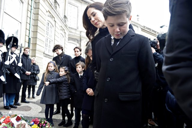 Denmark's Crown Princess Mary and Prince Christian look at flowers in front of Amalienborg Palace in Copenhagen, Denmark, February 15, 2018. Ritzau Scanpix Denmark/Mads Claus Rasmussen via REUTERS ATTENTION EDITORS - THIS IMAGE WAS PROVIDED BY A THIRD PARTY. DENMARK OUT. NO COMMERCIAL OR EDITORIAL SALES IN DENMARK.