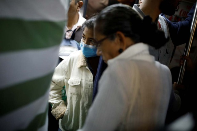 Yasmira Castano, 40, who lost her transplanted kidney, rides the metro after she received a dialysis session at a state hospital in Caracas, Venezuela February 14, 2018. Castano was unable to find the drugs needed to keep her body from rejecting the organ. On Christmas Eve 2017, she was rushed to a state hospital. Her immune system had attacked the foreign organ and she lost her kidney shortly afterwards. Picture taken February 14, 2018. REUTERS/Carlos Garcia Rawlins