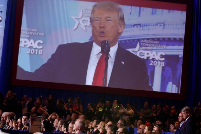U.S. President Donald Trump is shown on a monitor speaking at the Conservative Political Action Conference (CPAC) at National Harbor, Maryland, U.S., February 23, 2018.      REUTERS/Joshua Roberts