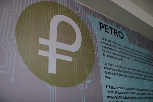 "The new Venezuelan cryptocurrency ""Petro"" logo is seen at a facility of the Youth and Sports Ministry in Caracas, Venezuela February 23, 2018. REUTERS/Marco Bello"