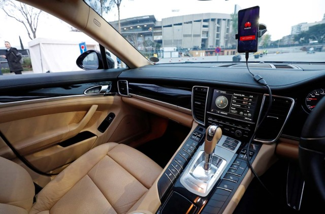 A Huawei Mate 10 Pro mobile is used to control a driverless car during the Mobile World Congress in Barcelona, Spain February 26, 2018. REUTERS/Yves Herman