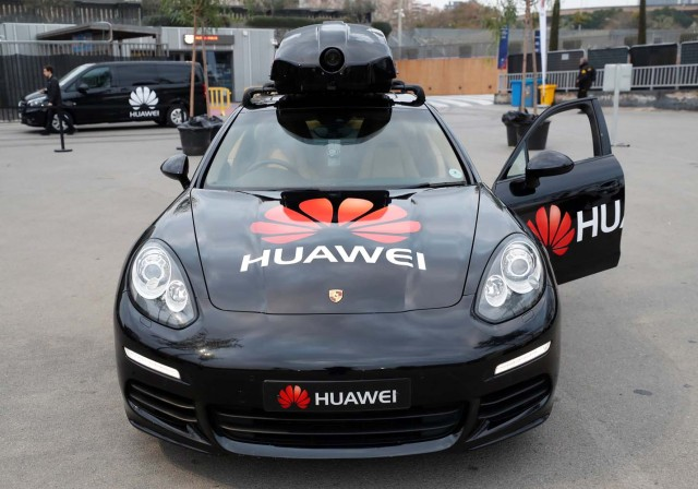 A driverless car controlled by a Huawei Mate 10 Pro mobile is pictured during the Mobile World Congress in Barcelona, Spain February 26, 2018. REUTERS/Yves Herman