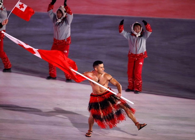 Pyeongchang 2018 Winter Olympics – Opening Ceremony – Pyeongchang Olympic Stadium- Pyeongchang, South Korea – February 9, 2018 - Pita Taufatofua of Tonga carries the national flag during the opening ceremony. REUTERS/Phil Noble