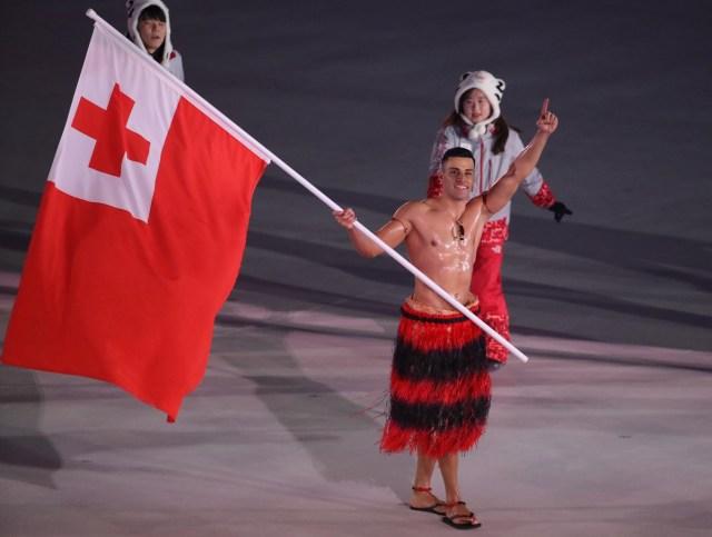 Pyeongchang 2018 Winter Olympics – Opening ceremony – Pyeongchang Olympic Stadium - Pyeongchang, South Korea – February 9, 2018 - Pita Taufatofua of Tonga carries the national flag. REUTERS/Carlos Barria