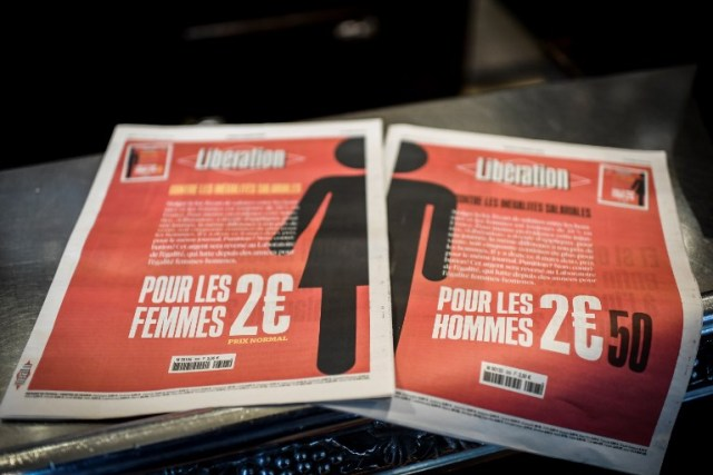 A picture taken on March 8, 2018 in Paris shows the two different front pages of the French daily newspaper Liberation during the International Woman's Day.    / AFP PHOTO / STEPHANE DE SAKUTIN