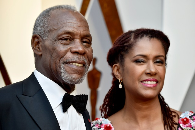 HOLLYWOOD, CA - MARCH 04: Danny Glover (L) and Eliane Cavalleiro attend the 90th Annual Academy Awards at Hollywood & Highland Center on March 4, 2018 in Hollywood, California. Frazer Harrison/Getty Images/AFP