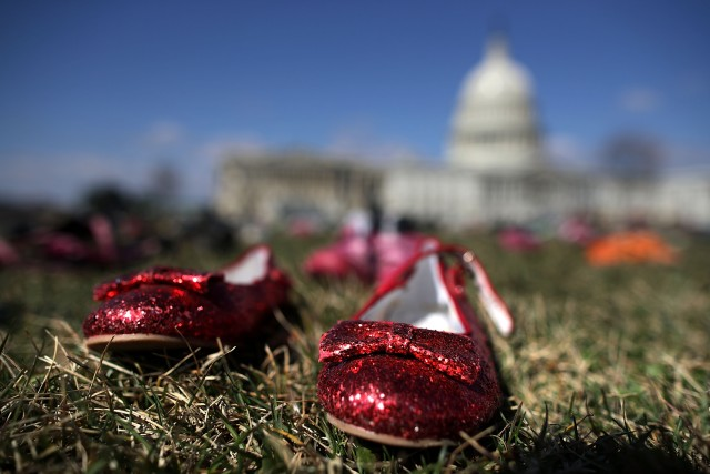 WASHINGTON, DC - MARCH 13: Seven thousand pairs of shoes, representing the children killed by gun violence since the mass shooting at Sandy Hook Elementary School in 2012, are spread out on the lawn on the east side of the U.S. Capitol March 13, 2018 in Washington, DC. Organized by the online activist group Avaaz, the shoes are intended to urge Congress to pass gun-reform legislation. Chip Somodevilla/Getty Images/AFP