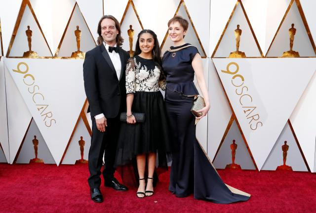 90th Academy Awards - Oscars Arrivals – Hollywood, California, U.S., 04/03/2018 – Anthony Leo, Saara Chaudry and Nora Twomey. REUTERS/Mario Anzuoni