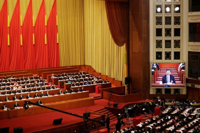 Chinese president Xi Jinping is seen on a giant screen after the parliament passed a constitutional amendment lifting presidential term limits, at the third plenary session of the National People's Congress (NPC) at the Great Hall of the People in Beijing, China March 11, 2018. REUTERS/Jason Lee